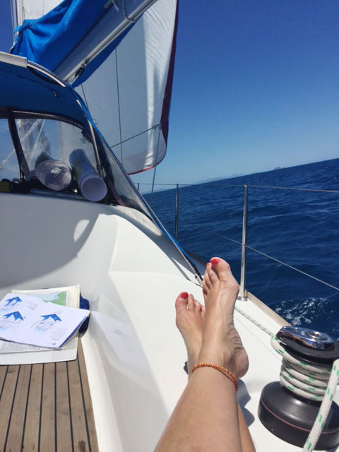 Relaxing under sail in the Whitsundays on a Charter Yachts Australia bareboat