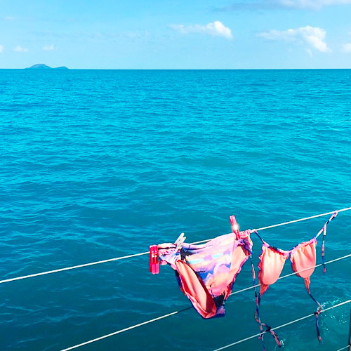 Bikini drying on lifelines overlooking Whitsunday waters