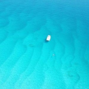 Charter Yacht Australia's Divocean Catamaran anchored at Whitehaven Beach