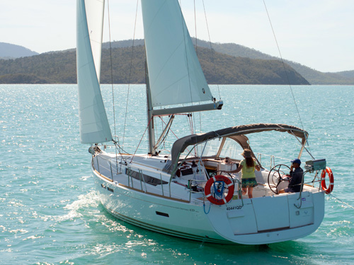 Sailing a yacht on pioneer bay, airlie beach