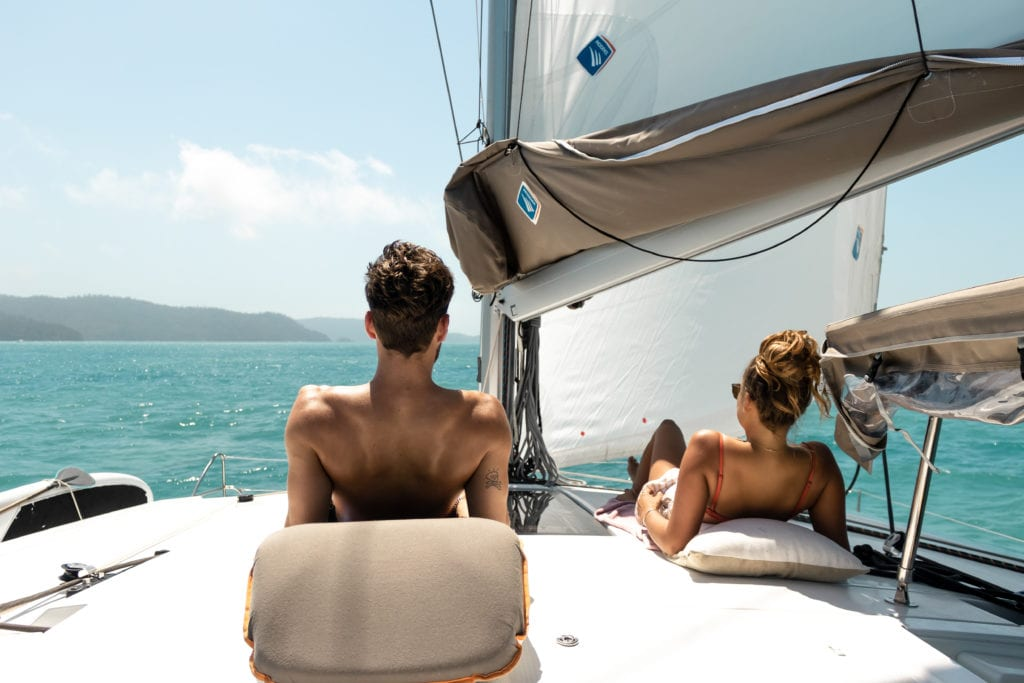 Relaxing on Deck image by @Thesailingyogi for Charter Yachts Australia