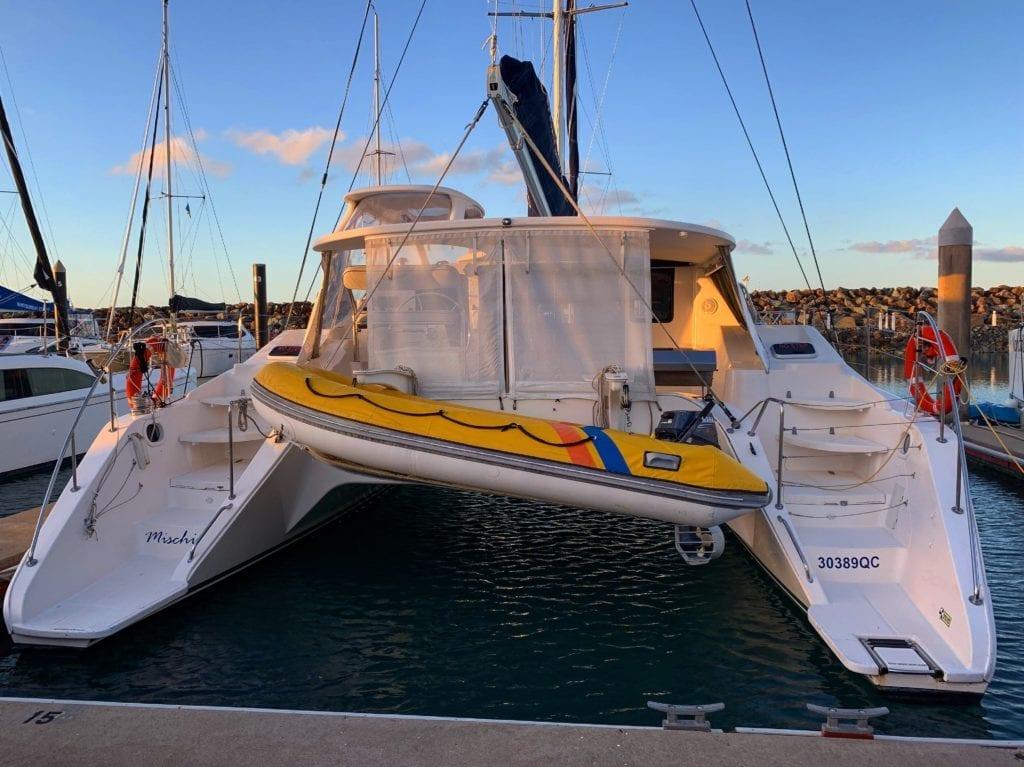 'Mischief' Lightwave 38 Sailing Catamaran Stern Blinds Down with Tender