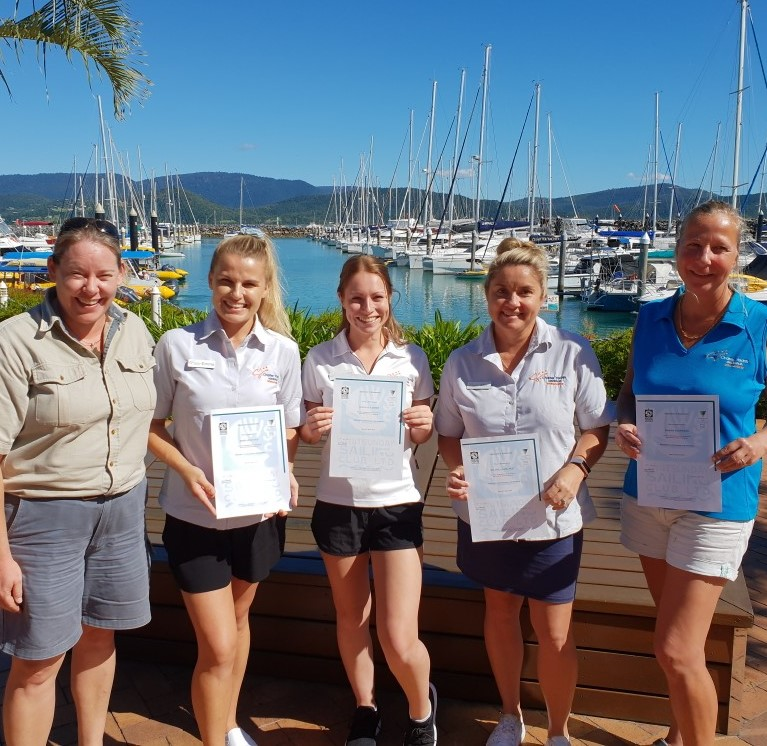 Charter Yachts Australia sales staff receiving their Bareboat Briefers certificates