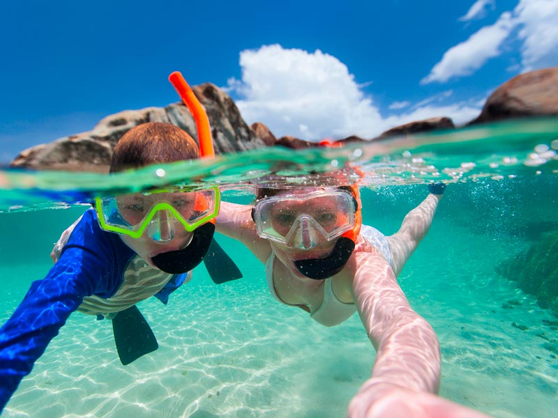 Children snorkelling in sheltered water