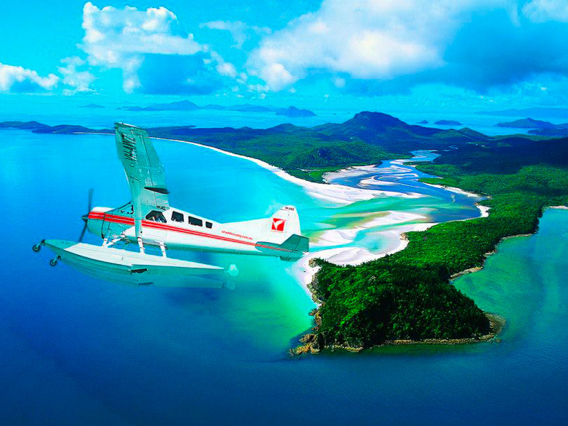 Air Whitsunday seaplane flying over Whitsunday Island